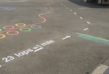Walk a Mile Playground Marking / Walk a Mile is a Marking designed to get children active. The Track is normally located around the outside of the school play area and tells the children the equivilent amount of laps that make up a mile.
