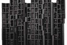 Louise Nevelson / Louise Nevelson (August 23, 1899 – April 17, 1988) was an American sculptor known for her monumental, monochromatic, wooden wall pieces and outdoor sculptures. Born in Czarist Russia, she emigrated with her family to the United States in the early 20th century when she was three years old. Nevelson learned English at school, as she spoke Yiddish at home. By the early 1930s she was attending art classes at the Art Students League of New York, and in 1941 she had her first solo exhibition. A student of Hans Hoffman and Chaim Gross, Nevelson experimented with early conceptual art using found objects, and dabbled in painting and printing before dedicating her lifework to sculpture. Usually created out of wood, her sculptures appear puzzle-like, with multiple intricately cut pieces placed into wall sculptures or independently standing pieces, often 3-D. A figure in the international art scene, Nevelson was showcased at the 31st Venice Biennale. Her work is seen in major collections in museums and corporations. Louise Nevelson remains one of the most important figures in 20th-century American sculpture.