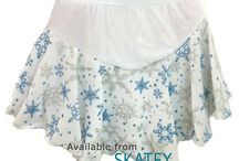 Snowflakes / Figure skating clothing and accessories with snowflake patterns.