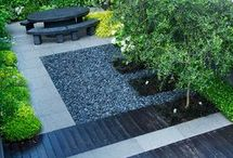 blue/grey/black & Hakonechloa macra in pebble/concrete garden