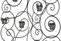 A Little Heavy Metal / Metal wall sconces, candle holders, metal grates, butterflies and other misc metal pieces of art.