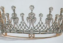 Tiara - Elizabeth Taylor / The tiara was created in the late nineteenth century. Old mine-cut diamonds are set in platinum and gold and shaped into alternating scroll and latticework elements. Mike Todd gave the tiara to Taylor in 1957, the year that they married.