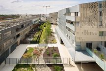 Dwellings in Toulouse: The Garden / This garden is an imagined recreation of the meandering landscape of the nearby river Garonne. Gravels, poplars and shrubs form lines inspired in materials and layout by the river.