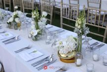 Chic Wedding / Simplicity was also accentuated on the dinner table settings with clusters of hydrangeas, phalaenopis, roses, lisianthus in white. Pops of gold was used as vases which was highlighted by flickers of candles at night. Would you look at those hanging fairy lights.
