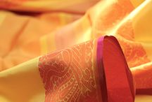 Mandanila: Colourburst Kanjivarams / The kanjivaram reveals its softer side in Mandanila, a collection of light and versatile silks in vibrant hues. The word Mandanila is sanskrit for zephry or mild breeze, echoing the softness of this gently flowing drape. Classic motifs are given expression in fine silken threads, juxtaposing brilliant bursts of colour. Explore this elegant avatar of the kanjivaram that adapts to any occasion while staying true to its heritage at www.kanakavalli.com.