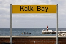 Kalk Bay Cape Peninsula  / This Cape Town fishing village is a buzz with local fisherman, bohemian shopping, antiques, crafts and superb restaurants, where you can easily lose yourself for an entire afternoon.  You'll have to ask the locals for their favourite place to eat as there are some closely guarded secrets in Kalk Bay. If you stay on the Cape Point Route long enough, be sure to enjoy a night out at the intimate Kalk Bay Theatre  for local entertainment and cuisine or arrange a fishing trip  with trek fisherman.