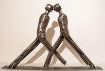 Humanoid metal art sculpture