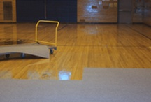 Protective Floor Coverings / Find a wide variety of protective floor covers for gym floors in schools and for special events. Consider durable vinyl rolls that are easy to roll out and roll back up for storage. Large protective carpet tiles are easy to install and durable for table and chair use in gym floors, schools and churches.