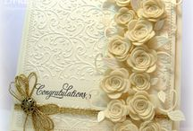 Creamy folded card. / Covered rt hand side with roses