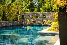 A Tropical Personal Paradise / Custom pool and spa backyard with vibrant colors and textures. Palm trees poolside give this place a Caribbean feel. Patio, kitchen and bar space make this the perfect backyard.