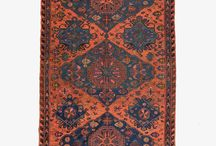 """Soumak / Soumaks are actually not kilims, but are very similar. They are also flat-woven in the same way that kilims are. However, they have a much more """"shaggy"""" style to them, as the embroidery threads are left and not cut at the back leaving loose strands of wool to them."""