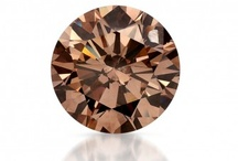 Pop! Champagne Diamonds / Popularly referred to as Champagne, Brown Diamonds are something to celebrate.  The warm colors of our natural Fancy Brown diamond collection provide the perfect backdrop to the fiery sparkle the diamonds give off.