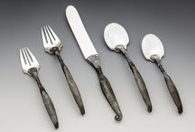Flatware / Serving Spoons, Salad Sets, Hors d'oeurve Sets, Cake Servers, Flatware, Gravy Spoons, Napkin Rings and More.  Hand forged heirlooms for a modern World.  Unique gift and bridal ideas!