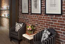 Brick wall ideas / Some people love them some people don't.  Exposed brick walls are not something to fear...you can decorate them just like any other wall.
