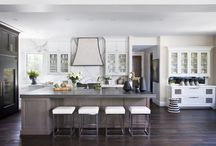 A Home with a Statement / A dramatic kitchen with statements to-boot. With a grand hood, ceiling height marble and a pewter island top, this focal point of this home — without a doubt — is the elegant kitchen.