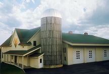 West Dover Firehouse / LineSync Architecture, as a cost-effective solution to a needed hose-drying tower, repurposed a farm silo, and the West Dover Firehouse with its distinctive silo has now become a beloved icon in the community.  Other features include a radiant heated floor, expansion opportunities in an unfinished second floor, allowance for a future elevator, and the economy of a metal systems building with the more efficient wall and roof envelopes available in wood frame materials.