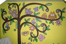 Forrest Tree mural / This mural shows a forest tree and animals, created for the nursery room of a baby girl. The client had seen a similar design that used stickers. However, it was felt that although stickers are great value for parents on a tight budget, they do not have the same passion or enchantment that a Kids Art Mural would have.