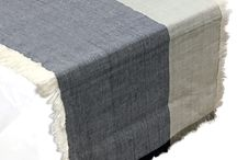 """Pehr Home Chambray Collection / Napkins and table runners are what really allow you to have fun mixing and matching.  All napkins are are 20""""l x 20""""w, machine washable and made from natural cottons.  Our runners are 14""""w x 90""""l and made from natural cottons.  The Chambray color black collection also has a fringe making this collection fresh! / by Pehr Designs - Pehr Home & Petit Pehr"""