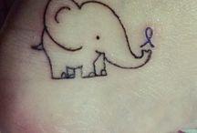 Tattoos / by Kenzie D