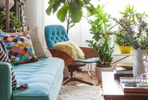 living room with turquoise couch