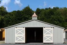 Trailside Horse Barn / This beautiful Trailside Modular Horse Barn measures 30 feet by 24 feet and features three horse stalls, a tack room, and a 10 foot by 24 foot center aisle. The barn's exterior is finished in in clay paint with tan trim and weathered wood colored roof tiles.