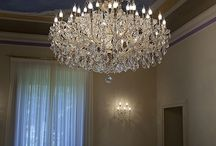 Private house - Cremona / Classic Maria Theresa chandeliers and wall lamps installated in a Private House in Cremona. The items are complete with colored and clear Swarovski Elements pendants.
