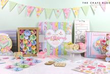 "Dovecraft Sweet Moments / Peer inside the paper pack to find vintage-style illustrations amidst a pretty pastel colour palette. Featuring scrumptious cakes, tea cups, macarons, and country flowers, these paper embody all the elegance of afternoon tea and patisserie. In 12"" x 12"", 8"" x 8"" and 6"" x 6"", this pad will be available in all of your favourite sizes!"