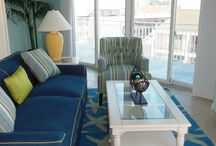 Vacation Beach Condo / A variety of fabrics yield the relaxed atmosphere of a beach style home.  By mixing different patterns, adding different hues of blues, coral and greens, we were able to create a peaceful relaxing vacation condo for our client.