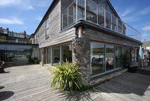 Project: Strand Court / This property in Salcombe utilising many elements of minimal windows sliding doors