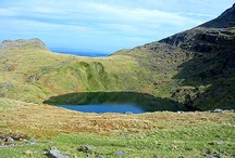 Tarn / Being a small mountain lake or pool, especially one in a cirque (a bowl-shaped, steep-walled mountain basin carved by glaciation, often containing a small, round lake).
