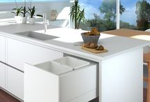 Tanova Pull Out Kitchen Bin Systems / Tanova design space-efficient, hygienic, easy to clean pull out kitchen bins that slide away out of sight, yet are easily accessed. DRAWER type units attach to a fixed front for one motion opening, while HANDLE type bins are installed behind a hinged door.  Multiple bin configurations in a wide range of cabinet widths offer excellent solutions for sorting/storing recyclables and organic kitchen waste. DELUXE units come with soft close. Most SIMPLEX units have soft close and push to open options.