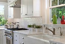 Subway tiles, farmhouse sink, all white, marble countertops.