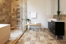 Healing Hinoki / Japanese Hinoki Ofuro Tub in wet area combined with shower, hidden shower drain with pebble shower floor, travertine tile with brushed nickel fixtures.