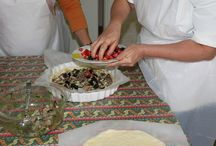 Tiella / Mama Isa's Tiella. Tiella is a southern Italian word for a baking pan and, by extension, its contents, often a savory pie. The town of Gaeta, near the border of Campania, has earned recognition for its tiella, a particular kind of torta salata (savory tart).  Perfect for antipasto buffets.  The tiella di Gaeta comes in many forms: here is with Fresh Octopus (boiled)m cherry tomatoes, garlic, parsley, black olives.......