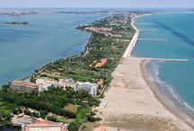 Lido island / The Lido — or Venice Lido (Lido di Venezia) — is an 11 kilometres (7 miles) long sandbar located in Venice, northern Italy, home to about 20,000 residents. The Venice Film Festival takes place at the Lido every September.
