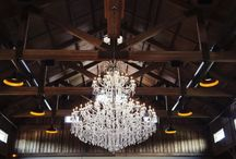 Main Hall / The Barn at Sycamore Farms is a new event venue located on 28 acres in the heart of Arrington, Tennessee capable of accommodating up to 400 guests for weddings, corporate events and private parties. The barn features cedar beams, crystal chandeliers, ladies and gentlemen's lounges, stone benches, two verandas overlooking the only island ceremony setting in Tennessee. The Barn at Sycamore Farms is designed for all seasons and weather conditions.