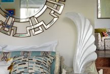 """Mufti in House and Garden / """"Interior designer Beata Heuman's Earls Court flat is small but perfectly formed.[...] A 'Geometric' mirror from Mufti takes the place of a traditional headboard. 'It's quite glamorous and a bit unexpected.' """""""
