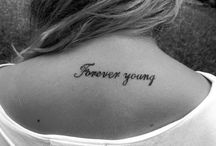 tattoozies / by Nicolette Blumer