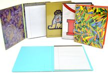 """Pictorial Padholders (8-1/2""""x11"""") / One of our best sellers! Full size, 8-1/2""""x11"""" Pad Holders.  Full-color high quality digital prints are """"entrapped"""" behind clear vinyl. Choose your school logo, mascot, our designs or your own custom design. Then, choose an inside liner color from our extensive line of high quality vinyls. Contour pocket on inside front cover. Includes header tablet inserted inside back cover."""