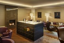 Cigar Lounge / The Cigar Lounge in the Hotel Schweizerhof offers hotel guests and non-residents alike the attractive opportunity of enjoying the catering and service quality of the Schweizerhof in a luxurious smoking room. The modern and elegant fumoir exudes a warm, refined atmosphere.