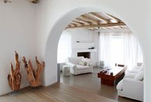 Rodanthe Retreat | Mykonos Villas / Playfully twisting Cycladic white architecture and minimal aesthetics, the property delights with its dominating white, the beautiful soft round arches discreetly interconnecting the open spaces, the simplistic yet highly creative interior styling and the overall feeling of comfort and freshness it radiates.