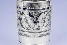 Серебряные стаканы и подстаканники
