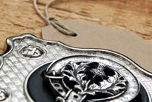 Clan Crests and Engraved Items with Crests / Made in Scotland by Art Pewter, all of our items are available in over 100 Clan Crests, plus Scottish Thistle and Scottish Piper.