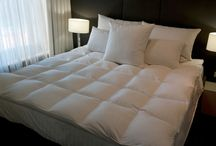 Mattress Toppers / Supreme Quilts mattress topper uses a boxed construction to help keep uniformity across the whole mattress. Down toppers allow all-year-round comfort as feather and down is a natural product which breathes better than synthetic filler and as well as wool.