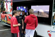 Ultimate Mobile Gaming! Book a Birthday Party Today! / Ultimate Mobile Gaming brings the Ultimate Gaming Experience right to your front door! Our luxury, limo-style Theater on wheels features FIVE wide screen HD TVs, surround sound, custom lighting with multiplayer gaming excitement! A total of 24 friends can play at the same time with room for 8 more friends on our stadium seating! We have all the latest titles from Xbox 360, Wii, Wii U and PlayStation 4!