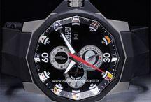 """Corum / Il marchio Corum nasce ufficialmente nel 1955 a La-Chaux-de-Fonds in Svizzera, grazie al talento di Gaston Ries, più attento ai dettagli, e suo nipote René Bannwart, più attento all'estetica. """"La chiave per il tempo perfetto"""" è il motto d'origine del marchio, oltre ad esserne il logo e il simbolo grafico (una chiave in verticale, appunto) che ne decora i quadranti..."""