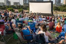 Austin Sound & Cinema: Music & Movies on the Lawn / Austin Sound and Cinema is a weekly summertime event providing live music and popular movies on the lawn of the Long Center. Bands perform a tribute to the movie, followed by the film screening on a giant inflatable outdoor screen with the perfect view of the sun setting on the downtown Austin skyline behind the stage.