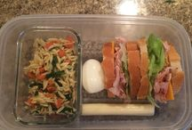 My Lunch Box / I have always struggled with what to pack for lunch.  I recently decided to kick it up a notch. My lunches are now filled with vegetables, fruit, healthy snacks,and  tons of protein.  My lunch box is a make-shift bento box. I use small Tupperware and silicone cupcake cups to keep things separate and help with portion control.  Lunch has never been so good.