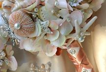 Seashell Bouquet / Bridal bouquets made with seashells.  Bridesmaid bouquets and boutonnieres with beach shells.