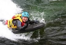 Riverboarding / In Riverboarding, the person surfs or moves along the strong water current with the help of a single board.It is also known  as hydrospeed.